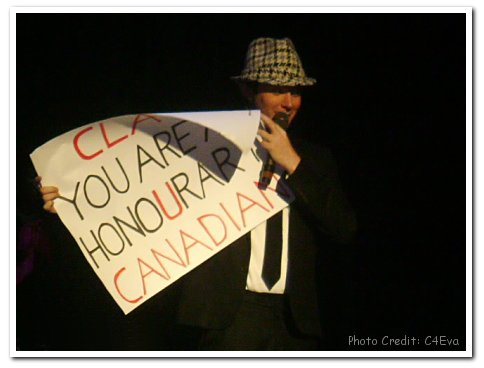 Clay Aiken holding sign: Clay You Are An Honourary Canadian - Photo Credit: C4Eva